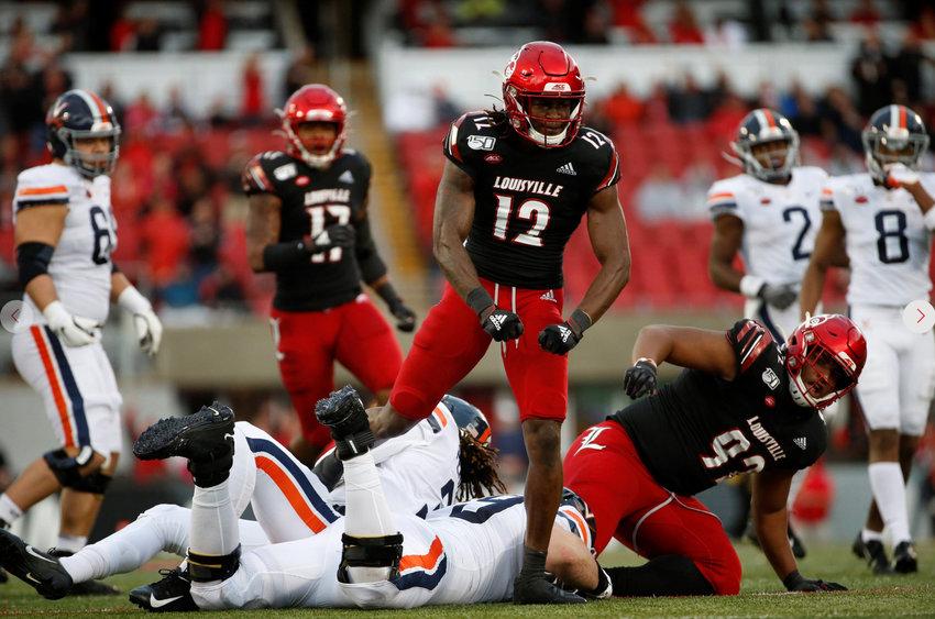Louisville's Marlon Character flexes after making a tackle against Virginia. The Cardinals take a 6-3 record into Saturday's home game with Virginia. (Louisville Athletics photo)