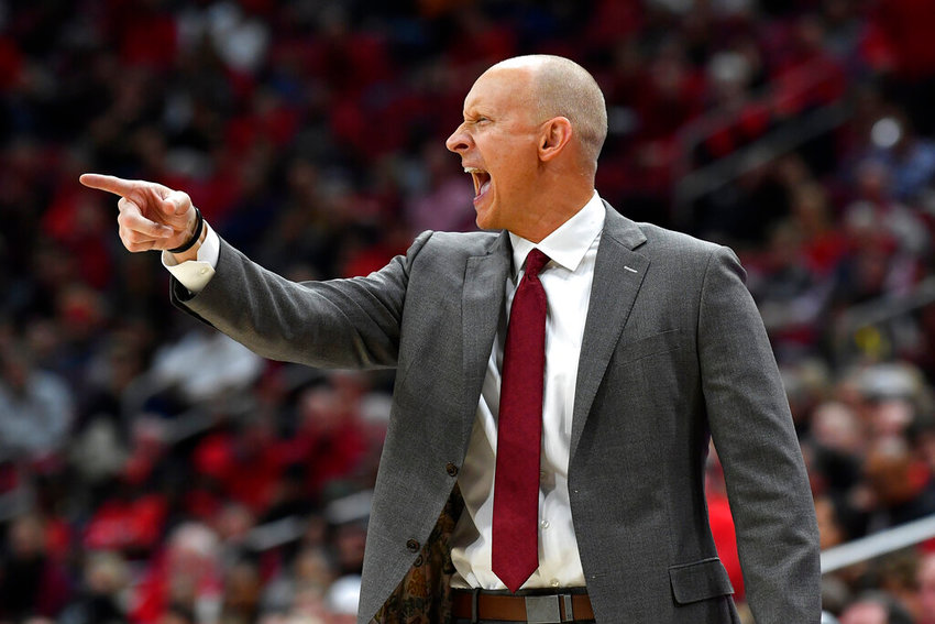 Louisville head coach Chris Mack shouts instructions to his players during the second half of an NCAA college basketball game in Louisville, Ky., Sunday, Nov. 24, 2019. Louisville won 82-76. (AP Photo/Timothy D. Easley)