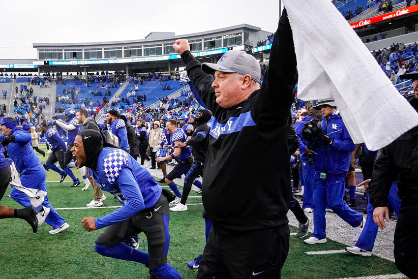 Kentucky coach Mark Stoops celebrates after winning an NCAA college football game against Louisville, Saturday, Nov. 30, 2019, in Lexington, Ky. (AP Photo/Bryan Woolston)