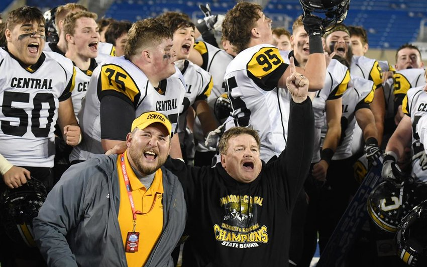 Coach Jim Matney and Johnson Central celebrate after defeating Boyle County 21-20 to win the Class 4A title in a battle of undefeated teams. (The Daily Independent/Kevin Goldy)