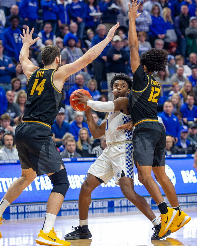 Ashton Hagans looks for an open teammate in the Wildcats' win over Missouri last weekend. Hagans is listed as day-to-day going into Tuesday night's game at Georgia. (Kentucky Today/Tammie Brown)