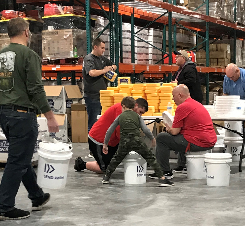 Volunteers pack up buckets that were sent to flood victims in Mississippi. (Submitted photo)