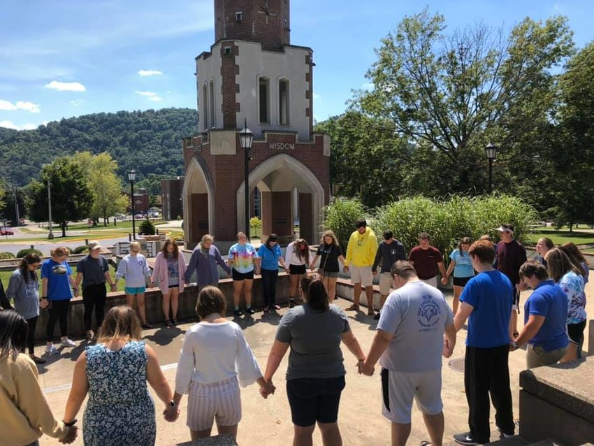 Morehead State Baptist Campus Ministry praying together.