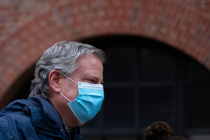 Be sure to have masks on to protect senior adults age 65 ad older wjo are at high risk for severe illness from the virus, according to the CDC. (AP Photo/Mark Lennihan)