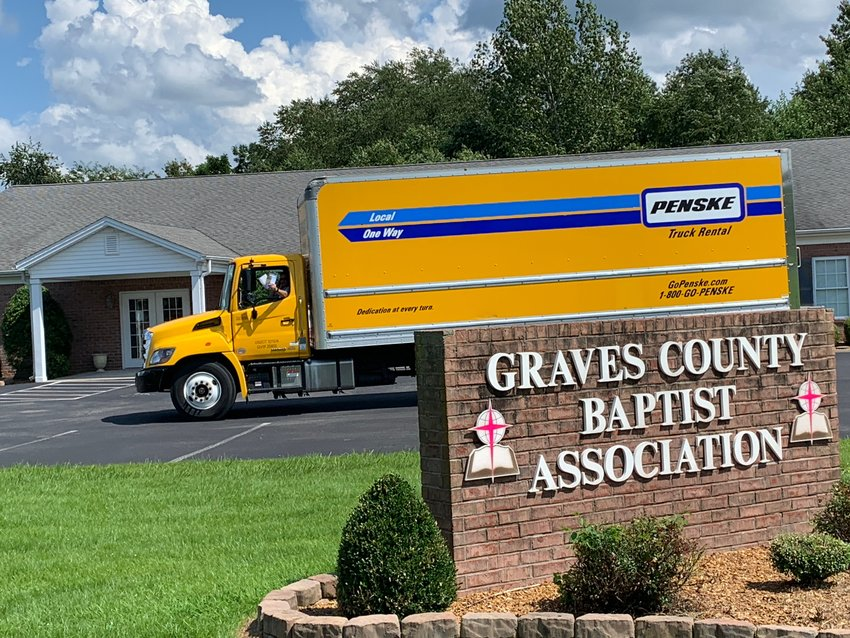 Rob Patterson waves out the bus window on a stop at the Graves County Baptist Association this week.