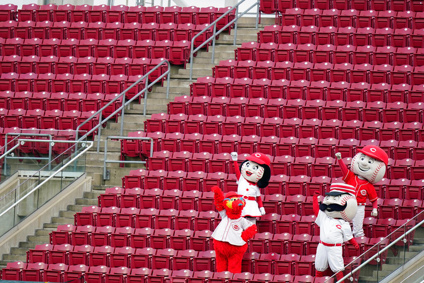 Cincinnati Reds mascots cheer from the outfield during a baseball game against the Pittsburgh Pirates at Great American Ballpark in Cincinnati, Thursday, Aug. 13, 2020. (AP Photo/Bryan Woolston)