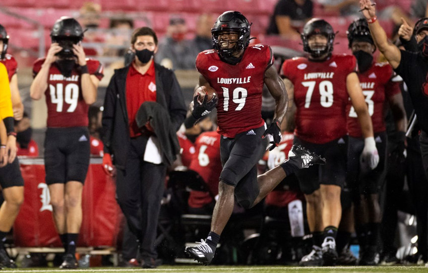 Hassan Hall runs to the end zone during the game against WKU on Sept. 12 at Cardinal Stadium. (Louisville Athletics / Taris Smith)