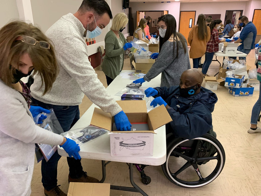 Immanuel Baptist in Corbin put together 10,000 Gospel to Every Home packages in less than an hour. They distributed nearly 3,000 on Sunday.
