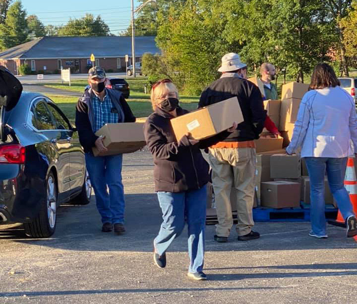 First Baptist of Lawrenceburg church member Sandy Gregory carries a box of food to a car on Oct. 2. The church will have a second food distribution day on Friday from 9 to 11 a.m. at the Anderson County Park.
