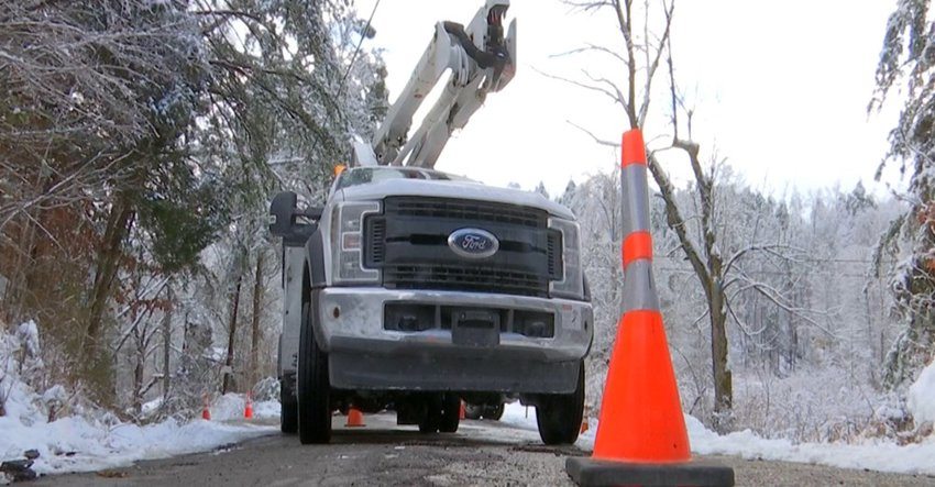 Kentucky Power truck working on downed lines.