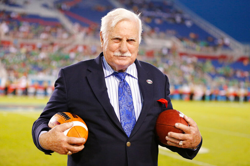 Former Louisvillei head coach, Howard Schnellenberger holds the game balls prior to the start of the Boca Raton Bowl NCAA college football game between Marshall and Northern Illinois on Tuesday, Dec. 23, 2014, at FAU Stadium in Boca Raton, Fla. (AP Photo/Joel Auerbach)..