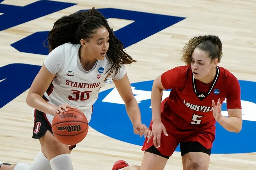 Stanford's Haley Jones tries to drive past Louisville's Mykasa Robinson during the first half of an NCAA college basketball game in the Elite Eight round of the Women's NCAA tournament Tuesday, March 30, 2021, at the Alamodome in San Antonio. (AP Photo/Morry Gash)