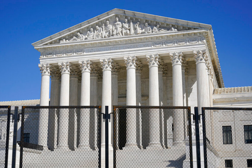 In this March 21, 2021, file photo security fencing surrounds the Supreme Court building on Capitol Hill in Washington. Biden on Friday, April 9, ordered a study of adding seats to the Supreme Court, creating a bipartisan commission that will spend the next 180 days examining the incendiary political issues of expanding the court and instituting term limits for justices on the highest bench. (AP Photo/Patrick Semansky, File)