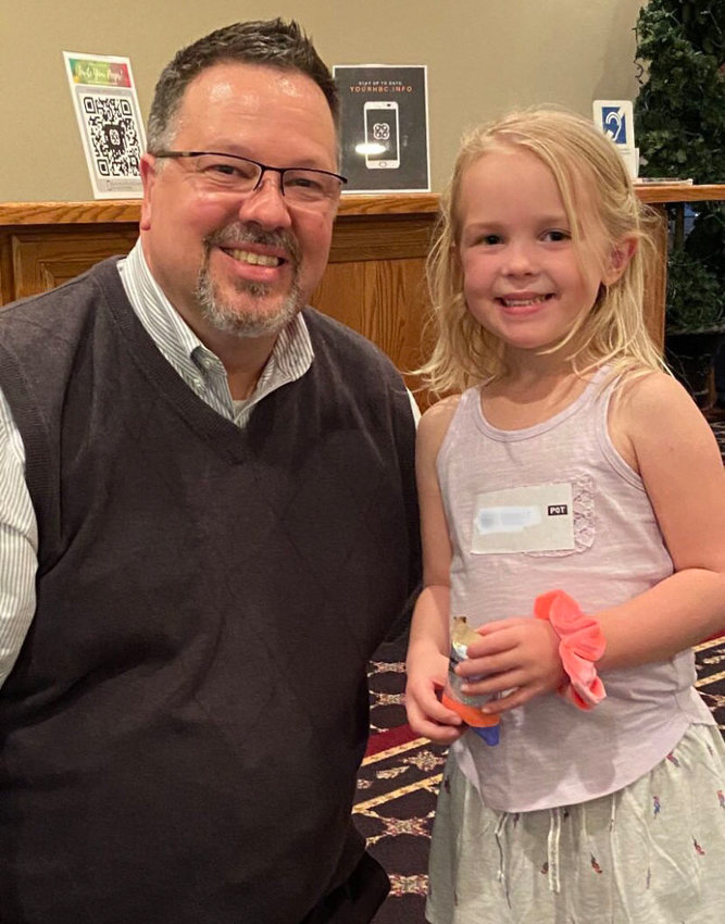 Pastor Larry Robertson is with Maci Parker, 6, who raised $54 for the Annie Armstrong offering.