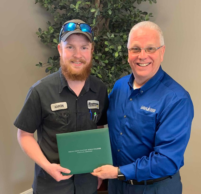 Clear Creek Baptist Bible College President Donnie Fox (right) presents a bivocational ministry certificate to Aaron Lee, who works as an auto mechanic in Louisville. Lee is a member of Ormsby Heights Baptist Church. (Submitted by David Scott)