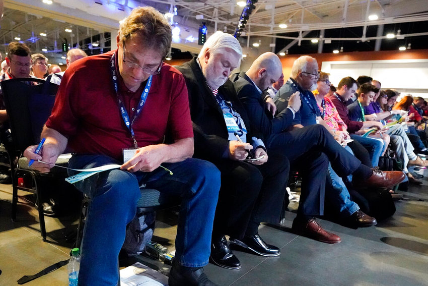 People vote on the first ballot for president of the Southern Baptist Convention during the denomination's annual meeting Tuesday, June 15, 2021, in Nashville, Tenn. (AP Photo/Mark Humphrey)