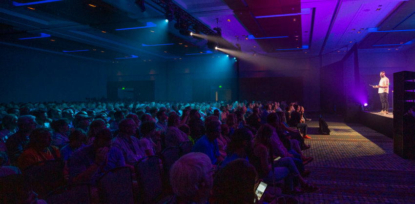 The first thing the capacity crowd heard at the June 13 prayer gathering at the Nashville's Music City Center was a story about the salvation of an MCC worker only a few minutes before. (Photo by Eric Brown)