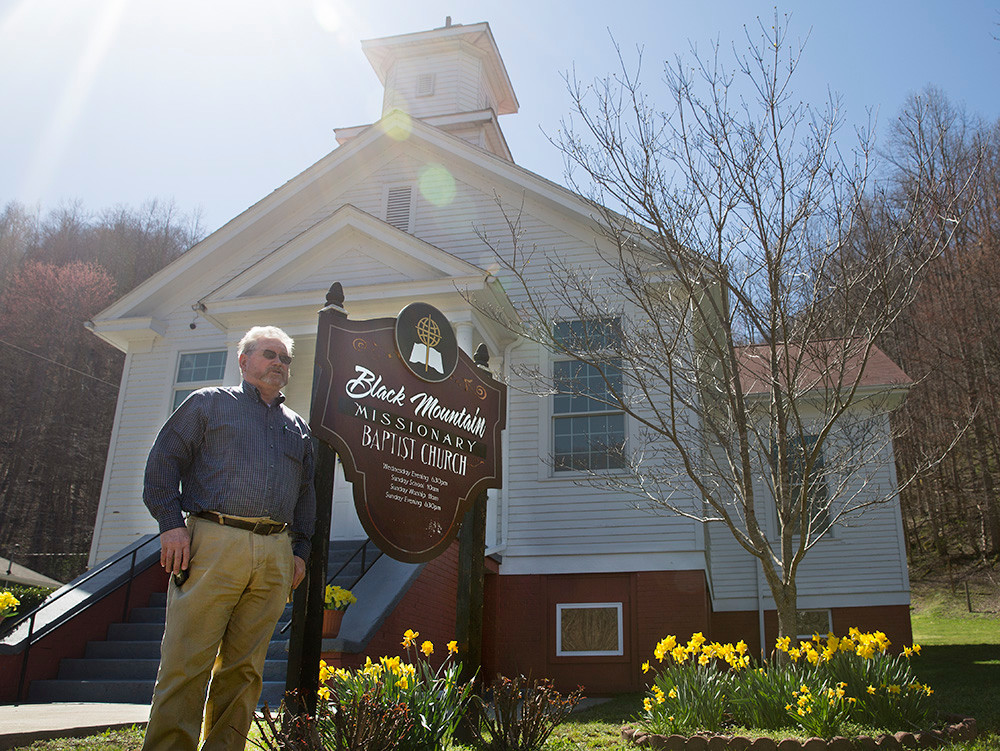 Bill Wallace, director of missions in the Upper Cumberland Baptist Association, stands in front of Black Mountain Missionary Baptist Church, which an arsonist tried to destroy. (Kentucky Today/Roger Alford)