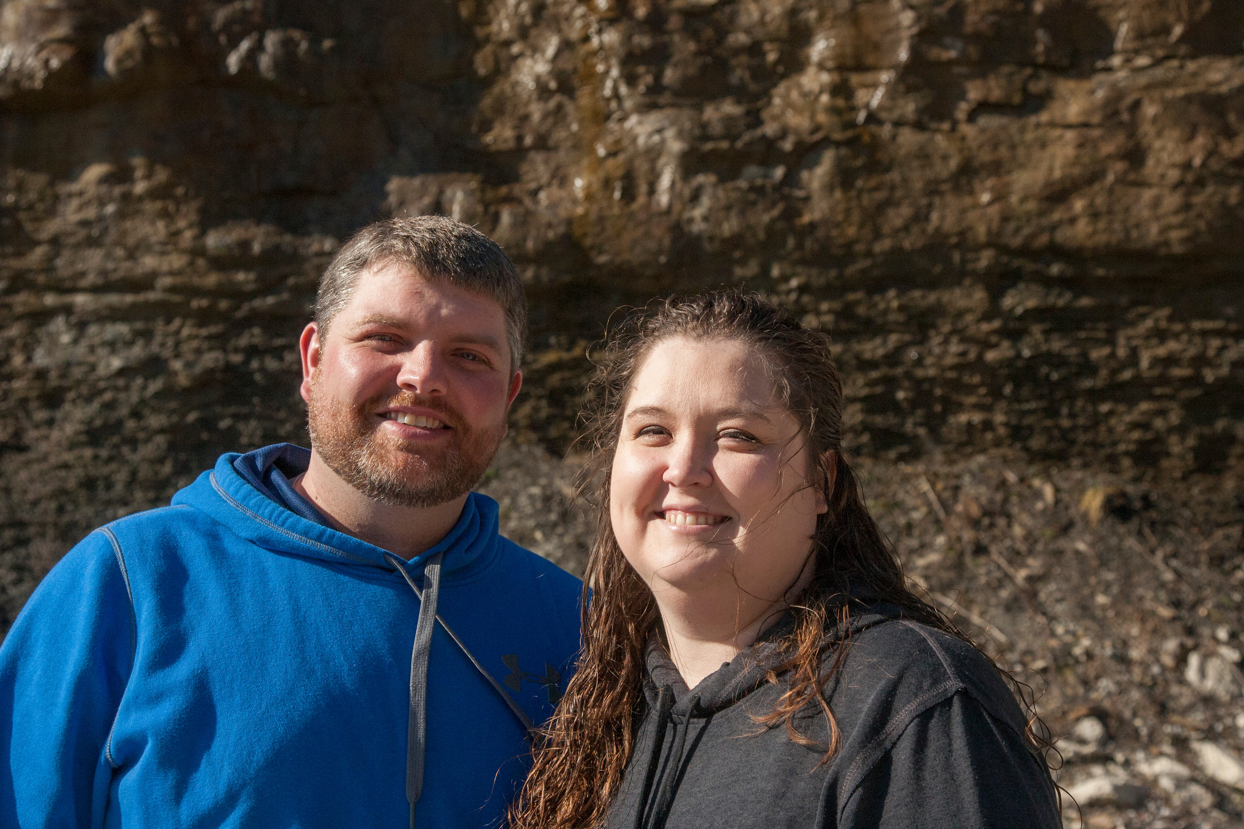 Justin Johnson stands with his wife Christy outside an idled coal mine in eastern Kentucky. He now commutes 4 hours to a factory job in northern Kentucky and sees his family on weekends. (Kristen Lowry/Kentucky Today)