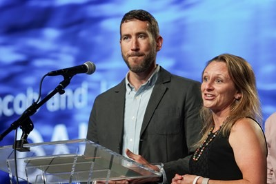 Keith Weiser, pastor of Resonate Church in Washington, and his wife Paige give a testimony during the SBC Executive Committee report at the Southern Baptist Convention annual meeting in the Phoenix Convention Center. (Matt Miller/Baptist Press)