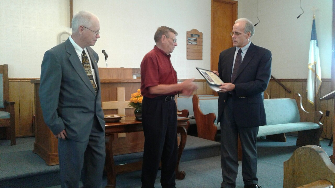 Johnny Aldridge, center,  is presented an award from Kentucky Baptist Convention business manager Lowell Ashby, right, as Pastor Tim Johnson watches. Aldridge has served as treasurer at Fellowship Baptist Church in Lawrenceburg for the past 50 years.