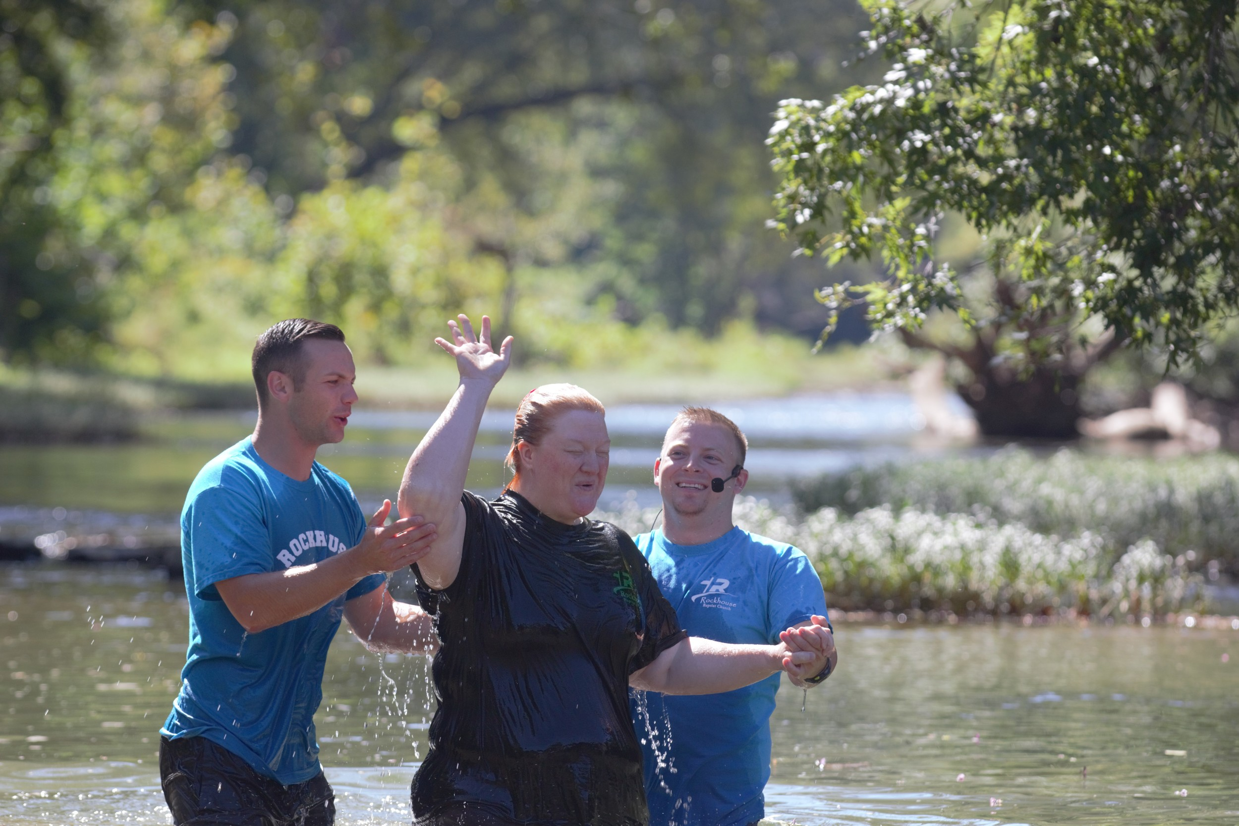 Rockhouse Baptist Church Pastor Tyler Shields, right, baptizes one of about 20 people in the Middle Fork of the Kentucky River. (Kentucky Today/Roger Alford)