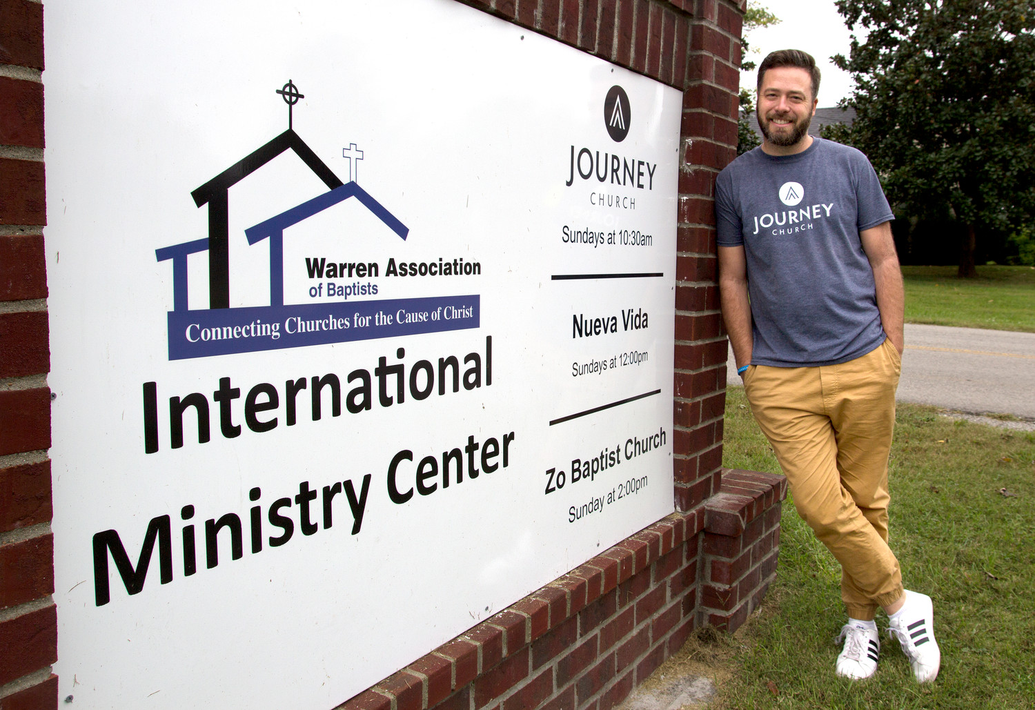 Matt Betts, pastor of Journey Church in Bowling Green, stands beside a sign pointing the way to his congregation, which launched in September. (Kentucky Today/Roger Alford)