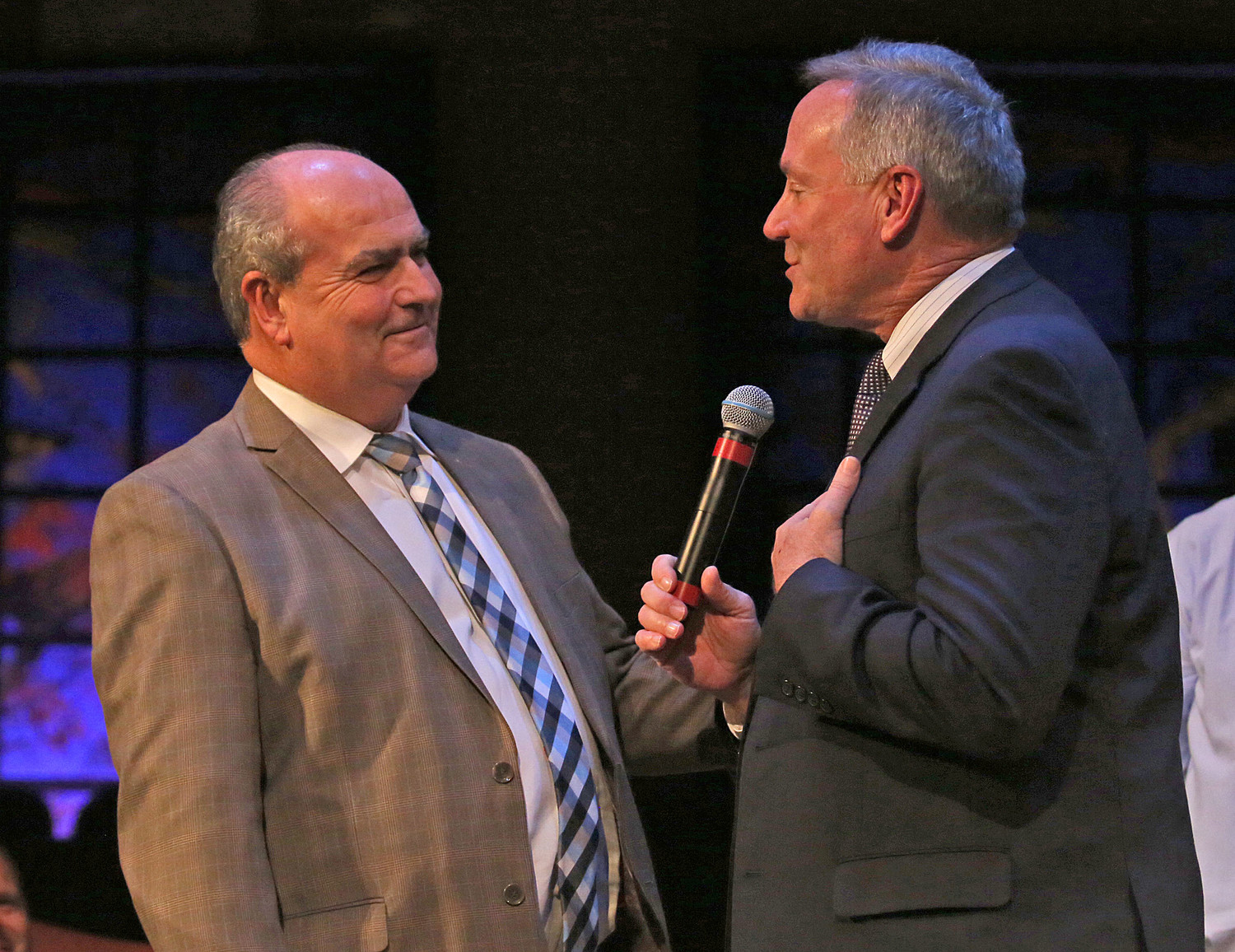 Outgoing Kentucky Baptist Convention President Bill Langley , right, congratulates incoming President Charles Frazier on his election at Tuesday's annual meeting at Highview Baptist Church's east campus in Louisville, Ky. (Kentucky Today/Robin Cornetet)