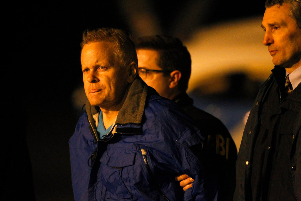 Fugitive lawyer Eric Conn is taken into custody by FBI agents on the tarmac at Blue Grass Airport in Lexington, Ky., Tuesday, Dec. 5, 2017. Conn, who spent six months on the run after pleading guilty in a $500 million Social Security fraud scheme, was being flown back to Kentucky on Tuesday after he was caught outside a Pizza Hut in Honduras. (AP Photo/Matt Goins)