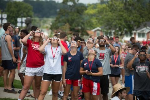 University of the Cumberlands students view last year's solar eclipse. The Kentucky school has eclipsed its previous enrollment record, reaching more than 10,000 students.