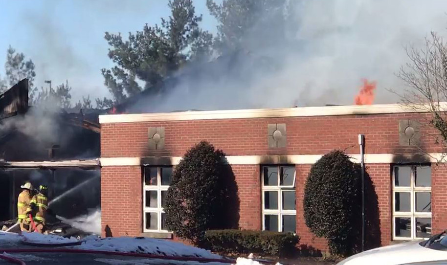 Firefighters douse flames at the Sunrise Children's Services activities center in Danville on Friday. No one was injured, but 27 boys were temporarily displaced. (Photo/Sunrise Children's Services)