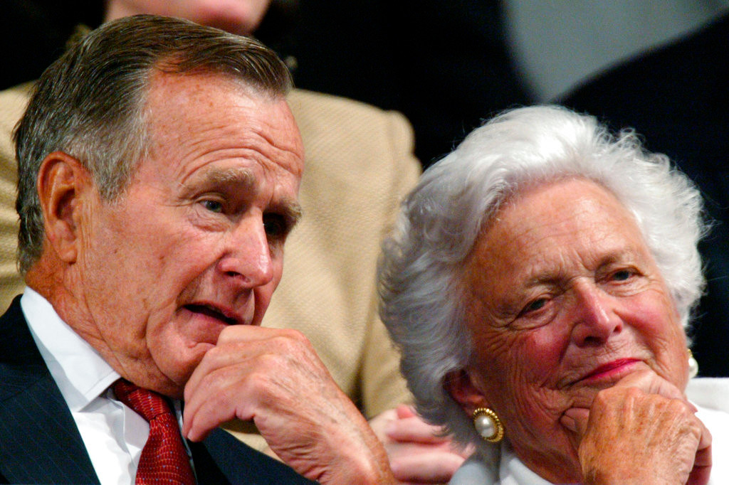 "FILE - In this Sept. 2, 2004, file photo, former President George H.W. Bush and former first lady Barbara Bush listen as the president accepts the party nomination at the Republican National Convention in New York. With her husband still at her side, Barbara Bush has decided to decline further medical treatment for health problems and focus instead on ""comfort care"" at their home in Houston. Family spokesman Jim McGrath disclosed Barbara Bush's decision Sunday, April 15, 2018. (AP Photo/Paul Sancya, File)"