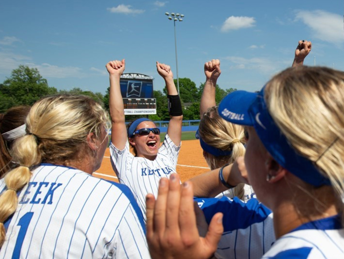 Members of Kentucky's softball team celebrate after the Wildcats defeated Notre Dame 8-0 in six innings to advance ti the NCAA Super Regionals next week at No. 1 seed Oregon. (UK Athletics Photo)