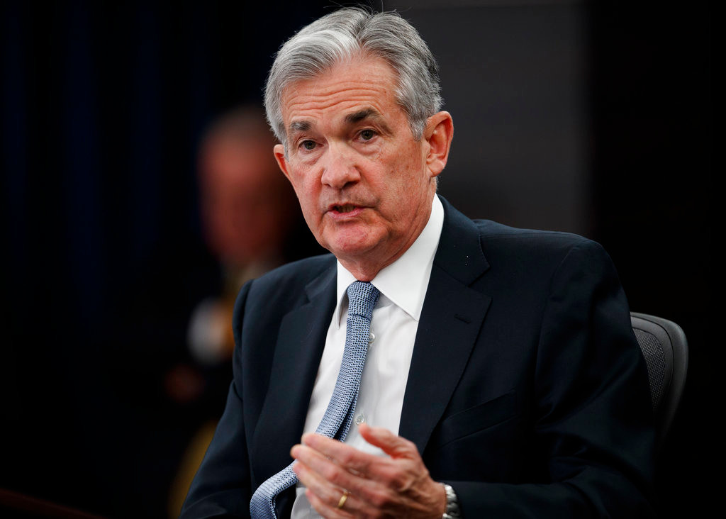 FILE- In this March 21, 2018, file photo, Federal Reserve Chairman Jerome Powell speaks following the Federal Open Market Committee meeting in Washington. Investors are eagerly awaiting the updated economic forecasts the Fed will issue when its meeting ends Wednesday, June 13. (AP Photo/Carolyn Kaster, File)