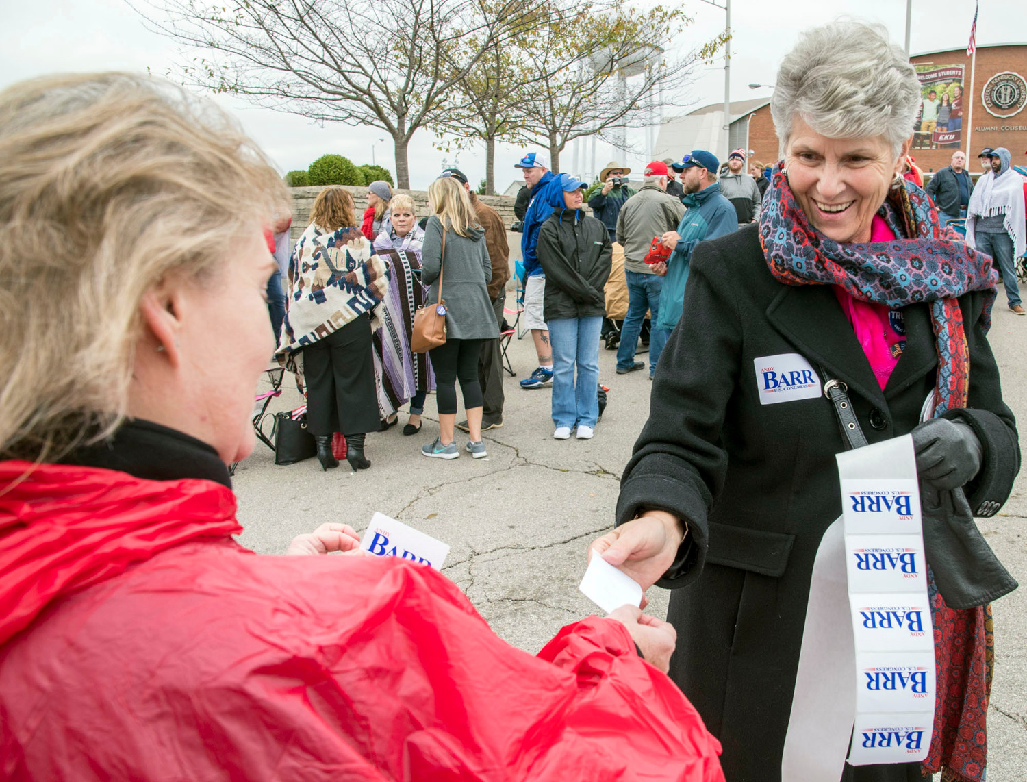 Paula Mauck, right, a campaign volunteer for U.S. Rep. Andy Barr, hands out campaign stickers Saturday October 13, 2018, before a campaign rally for U.S. Rep. Andy Barr, R-Ky., in Richmond, Ky. Barr faces Democrat Amy McGrath in the November general election. Photo by John Flavell / For Kentucky Today)