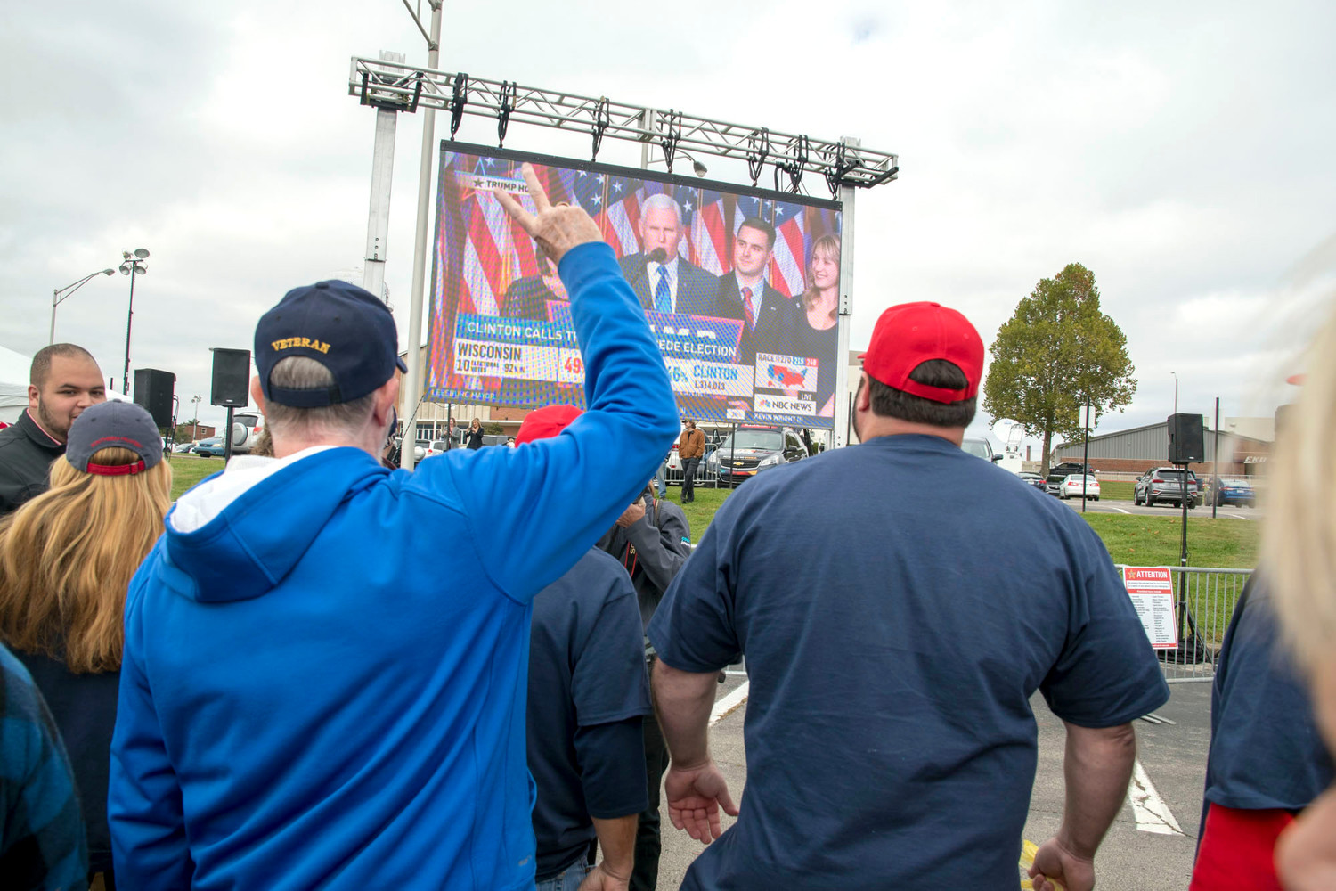 Donald Trump supporters react to electio night video playing on a large screen while waiting to enter Eastern Kentucky's Alumni Coliseum Saturday October 13, 2018, before a campaign rally for U.S. Rep. Andy Barr, R-Ky., in Richmond, Ky. Barr faces Democrat Amy McGrath in the November general election. Photo by John Flavell / For Kentucky Today)