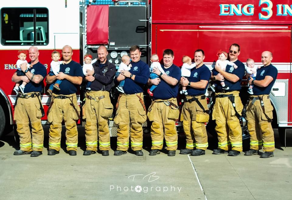 Eight firefighters from Ashland hold babies that were all born in 2018. That equals nearly 20 percent of the 50-man force at the Ashland Fire Department. (Photo courtesy of Tracie Brown of TB Photography)