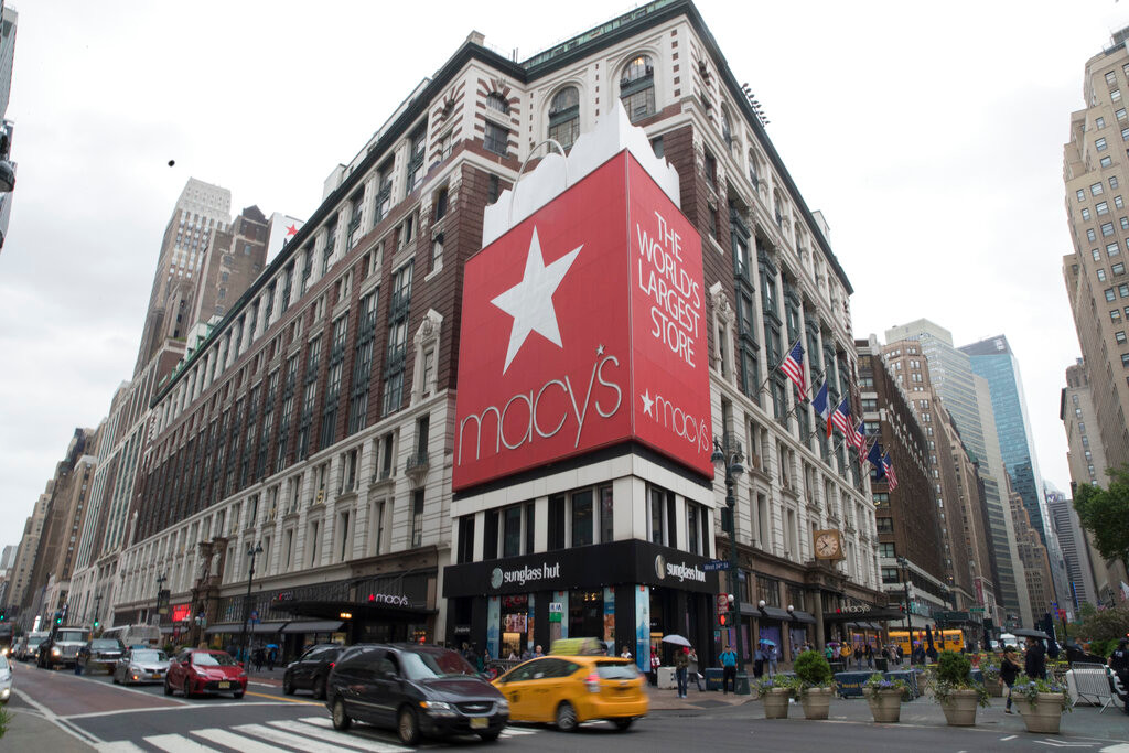 In this May 16, 2018, file photo, traffic makes it's way past the Macy's flagship store in New York. On Thursday, Jan. 10, 2019, Macy's reported that it saw only a slight increase of 1.1 percent in sales during November-December at stores opened at least year. And while sales were strong during Black Friday and Cyber Monday, the company said sales fell off noticeably until the week of Christmas. (AP Photo/Mary Altaffer, File)
