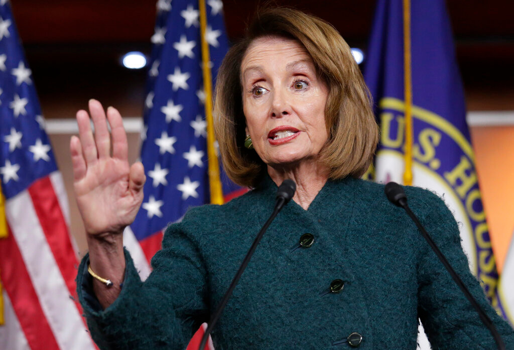 In this Jan. 10, 2019 photo, Speaker of the House Nancy Pelosi, D-Calif., meets with reporters in her first formal news conference, on Capitol Hill in Washington.   Pelosi has asked President Donald Trump to postpone his State of the Union address to the nation, set for Jan. 29, until the government reopens.