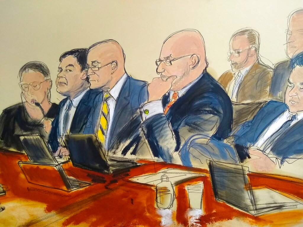 "In this courtroom drawing, Joaquin ""El Chapo"" Guzman, second from left, seated with his defense attorneys, listens to testimony that was read back to the jury, Monday, Feb. 11, 2019, in New York. On its fifth day of deliberations, the jury asked to review law enforcement testimony about seizures of Colombian cocaine being shipped to the Sinaloa cartel to fuel a smuggling empire prosecutors say was under Guzman's command. (Elizabeth Williams via AP)"