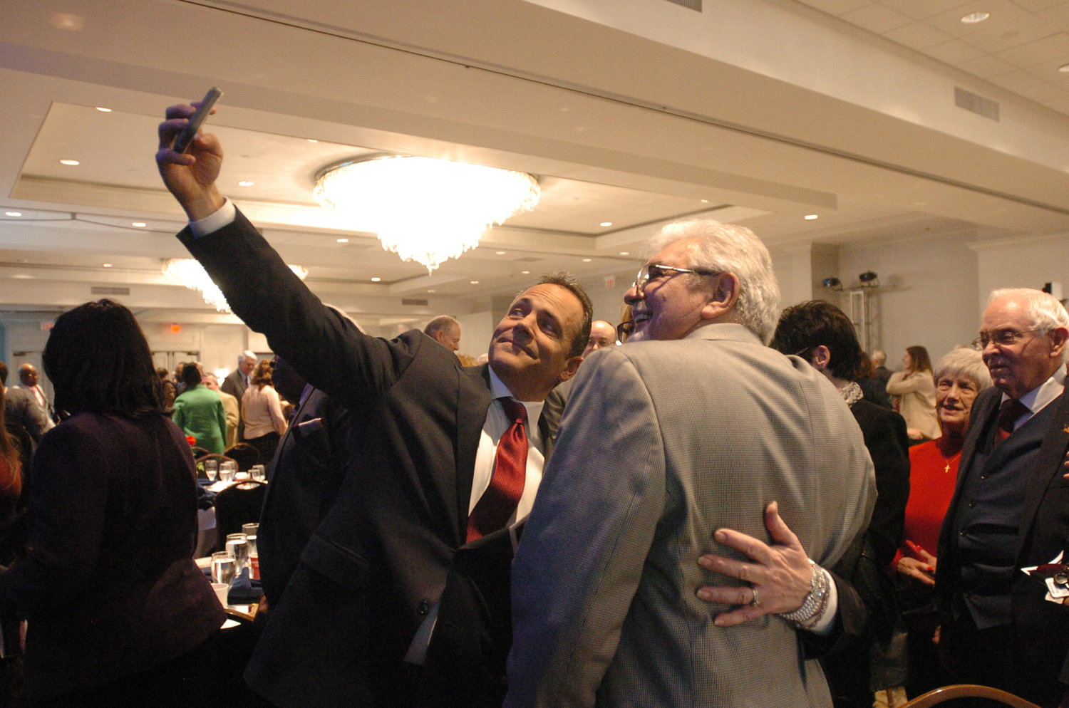 Gov. Matt Bevin takes a selfie at the Governor's Prayer Breakfast on Monday morning. (Kentucky Today/Chip Hutcheson)