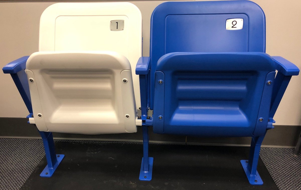The upper-level chair backs at Rupp will resemble these two replica seats and will be all blue in color. The chair backs will be installed beginning in June and reduce the arena's seating capacity to 20,500. (Kentucky Today/Keith Taylor)