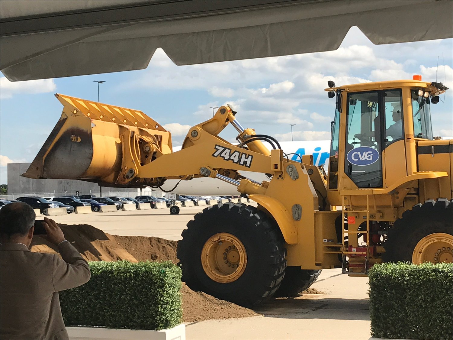 Amazon CEO Jeff Bezos, driving a front loader, moved the first load of dirt at the groundbreaking for the $1.4 billion Prime Air Hub at CVG Tuesday (Photo by Mark Hansel).