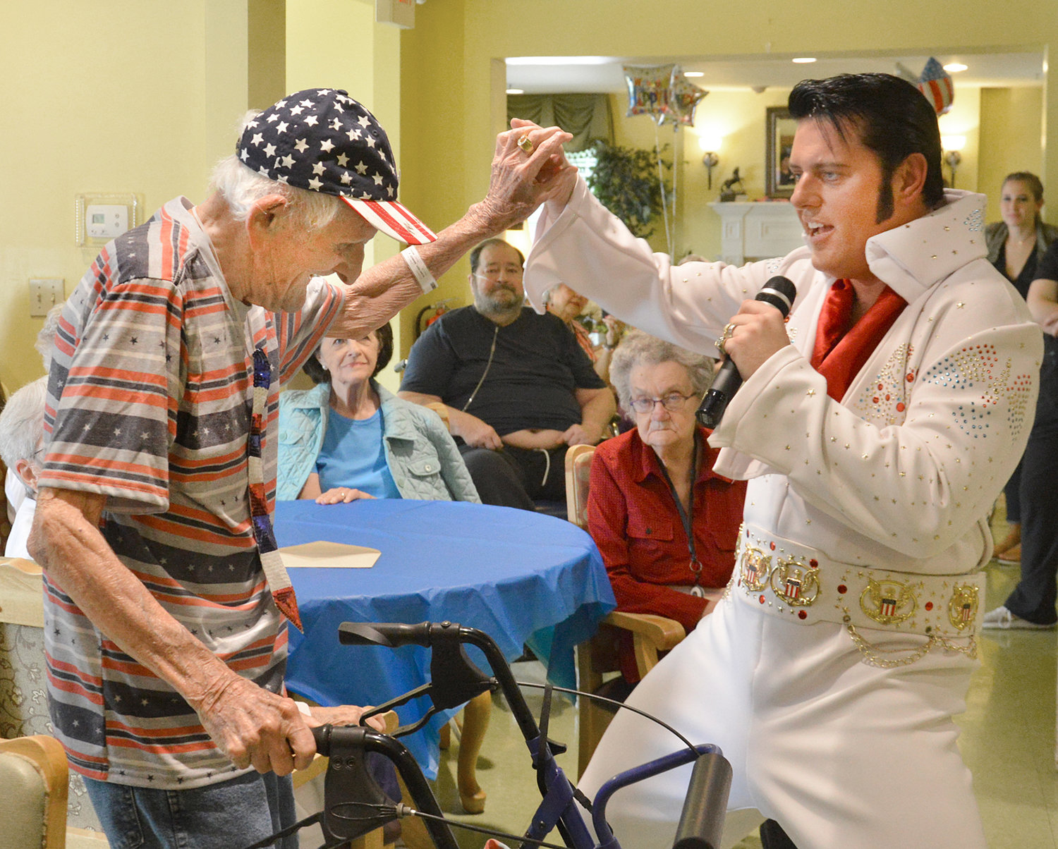 "Ernie Blanchet dances with ""Elvis,"" also known as Barry Lockard, during Blanchet's 106th birthday celebration Monday afternoon at Charleston Assisted Living facility in Danvile. (Photo by Robin Hart)"