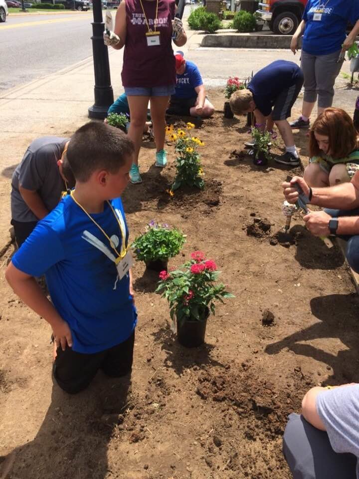 Landscaping was one of the activities the Mission Adventure for Kentucky. They will be putting these flowers at a ministry center in Hopkinsville. (Kentucky WMU Facebook photo)