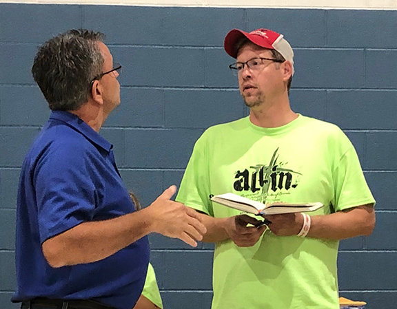 Unity Baptist Pastor Jeremy Couture, right, talks with Eric Allen of the Kentucky Baptist Convention on the rally night for the All In event put on through the Greenup Baptist Association. (Kentucky Today/Mark Maynard)
