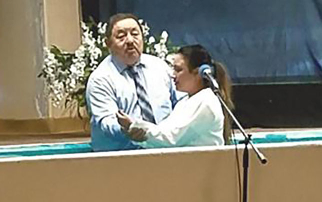 Raul Arreola, pastor of Buenas Nuevas Mission, Las Cruces, performs a baptism during one of many simultaneous revivals across New Mexico. (Submitted photo)