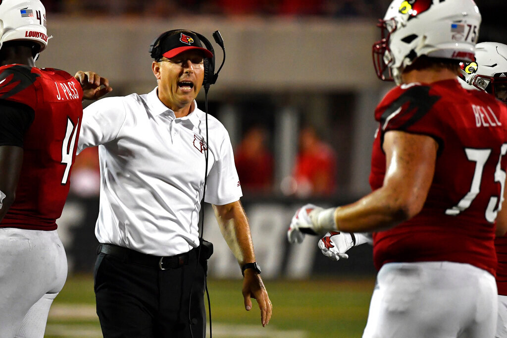Louisville head coach Scott Satterfield instructs players during the second half of an NCAA college football game against Eastern Kentucky in Louisville, Ky., Saturday, Sept. 7, 2019. (AP Photo/Timothy D. Easley)