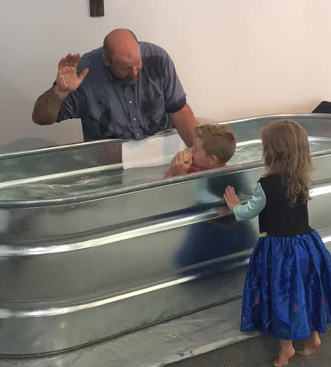 Pastor Bobby Ekers baptizes Marshall Short as his sister looks on at the Cornerstone Community Church near Ashland, Ky. (Submitted photo)