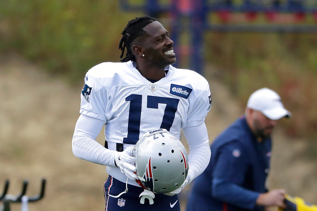 New England Patriots wide receiver Antonio Brown carries his helmet during an NFL football practice, Wednesday, Sept. 18, 2019, in Foxborough, Mass. (AP Photo/Steven Senne)